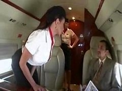 Nice-looking stewardess is fucking with a pair of businessmen on the board of a plane