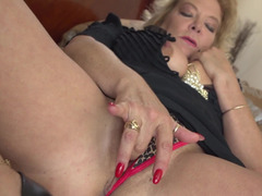 A hot granny is by herself, playing with her sensitive muff