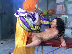 A attractive thing is getting fucked by a clown on the massage table