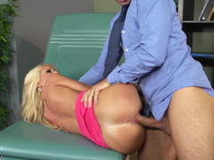 A blonde with big breasts is getting fucked hard by her doctor