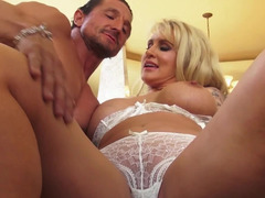 Handsome stripper has fun with big-breasted blonde