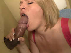 A dame that loves purple rod is pulling one through a glory hole