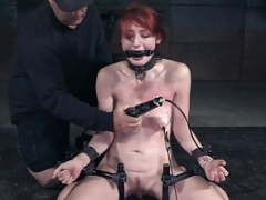 Redhead bdsm sub whipped and also clamped