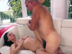 A grandpa is getting a blow job from a hot dame with a sexy round ass