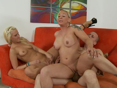 Blonde broads are on the sofa, naked & getting fucked
