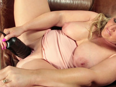Chunky eager mom stretches her pussy with a big black dildo