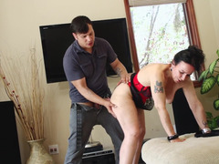 A brunette that has a firm butt is getting penetrated on the sofa