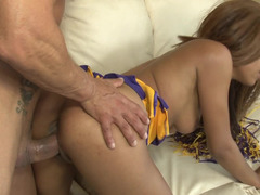 A black cheerleader is getting her twat penetrated on the sofa
