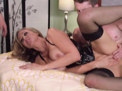 Leather underwear babe Julia Ann takes on a couple of horny men