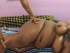 Jiggling boobs and belly on a black Adult bbw taking hard fuck pole