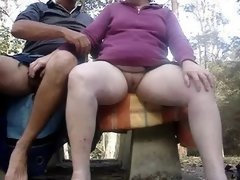 Masturbating together outdoors on a dripping wet day