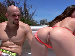 A bimbo is getting undressed on the boat and plus she is also getting fucked