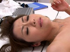 A hot chick with stockings is getting penetrated in the office