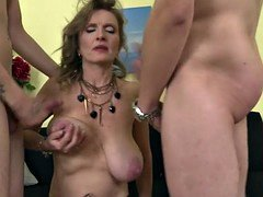 Adorable aged mom cum covered by a couple of sons