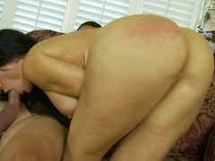 A brunette with large nipples is on the sofa, getting fucked hard