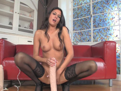 A kinky gal is playing with her pussy while alone in her room