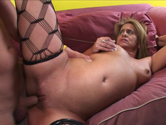 Aroused granny is getting a cock in her mouth and additionally in her slit
