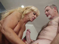 Blonde granny gives a blow job to a aroused gray dude