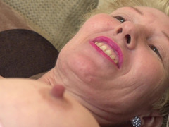 A hot granny is by herself, playing with her sensitive vag