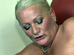 Big-breasted blonde grandma takes it in the ass