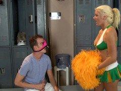 A bigtitted blonde cheerleader is getting penetrated in the locker room