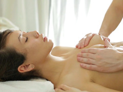 A smoking hot babe is on the massage table getting her ass kissed