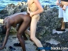 Black lady fucked by a couple of white dudes at seaside