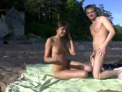 A couple is filmed as they`re doing it doggy style on the beach