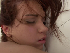 Playful doll is getting penetrated while on the white sofa