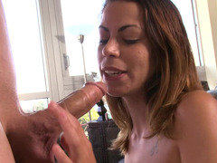 Brunette with big saggy boobs is setting her pussy on a purple pole