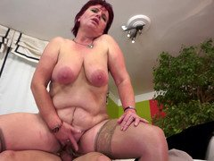 A large old granny redhead with large saggy tits is getting rammed