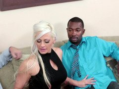 A blonde is getting fucked by a fit black guy next to her man
