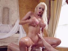 Bimbo masseuse Nicolette Shea is a handjob expert too