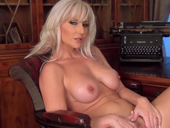 A mom i`d like to fuck with a sexy smile is alone in the office chair, fooling around