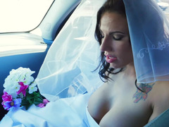 A dame gets penetrated in her wedding gown on the bed