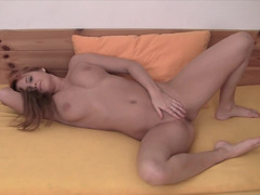 Busty redhead nicely touches her aching snatch