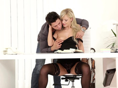 A big man is teasing a hot secretary while she doing some work