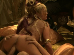 Sexy pirate broads are having an orgy on the bed by the candles