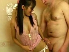Attractive petite Thai gal gives him a bj while in the bathtub
