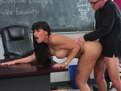 Fine minx with long hair is unclothing and besides fucked on the desk