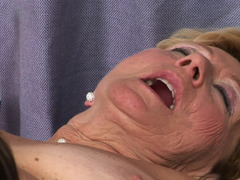 Granny plays with a hot thing that has huge natural tits
