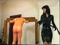 Guy is tied up and furthermore whipped as his latex clad domme abuses him