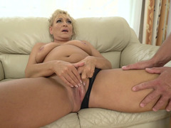 A granny with a saggy old body is getting some cock while she is in bed