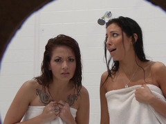 Two girls are spied on in the shower and they notice it going on