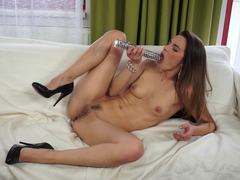 A large dildo shows up in this tight bitches little wet cunt