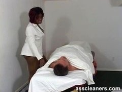 Plumpish ebony doctor smothers a complaining patient by sitting on his face so he can talk no more