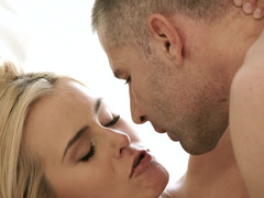 Girl that has a pretty face is giving a blow job to her man