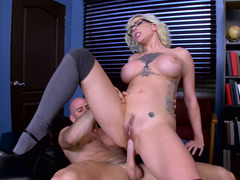 A breasty slut is getting penetrated in the office by the dean