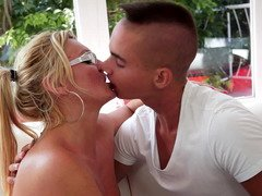 A blonde mature woman that has a big ass is getting fucked
