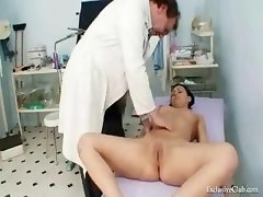 Vagina Exam By Aged Doctor At Clinic